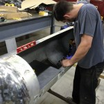 Welding in the baffle plate in two pieces.